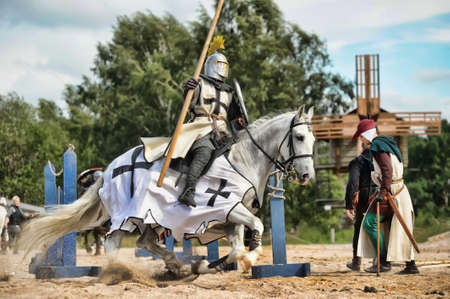 Knight on the horse taking part in tournament reconstruction, St. Petersburg, Russia