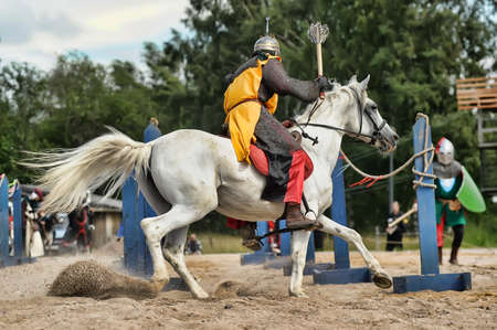 chrome man: Knight on the horse taking part in tournament reconstruction, St  Petersburg, Russia
