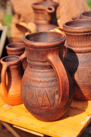 National culture ceramic handmade brown jugs on market photo