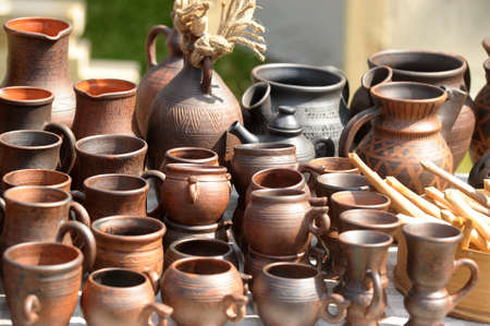 National culture ceramic handmade brown jugs on market photo