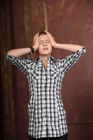 Female suffering from a headache photo