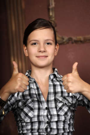 Teen beauty caucasian girl showing her thumbs up photo