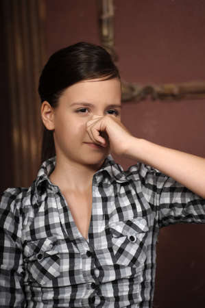 Girl holds her nose closed Stock Photo - 14979235