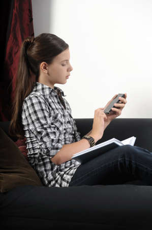 Teen girl using cell phone Stock Photo - 14965576