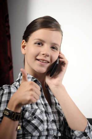 Teen girl using cell phone photo