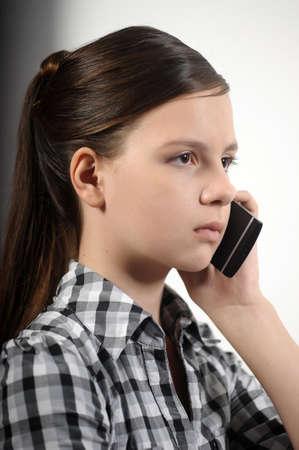 Teen girl using cell phone photo