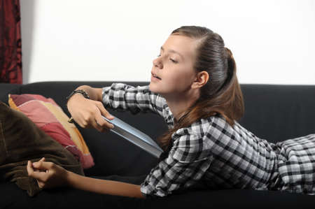 teen girl tired reading a book Stock Photo - 17996459
