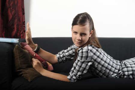 teen girl tired reading a book Stock Photo - 17996447