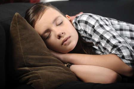 Teenage girl sleeping photo