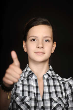 Teenage girl with thumbs up  Stock Photo - 14838265