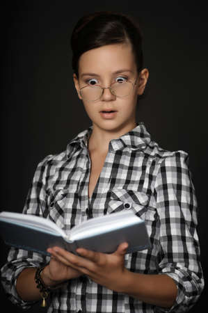 Woman in glasses with book photo