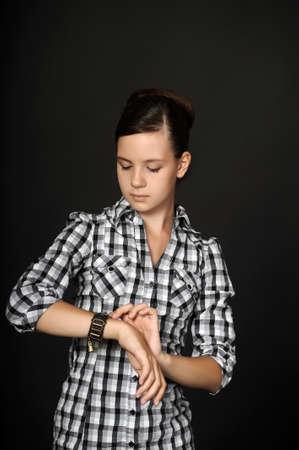 Teenage girl looking on her watch Stock Photo