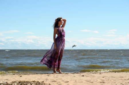 long lake: Young Woman Relaxing By The Sea