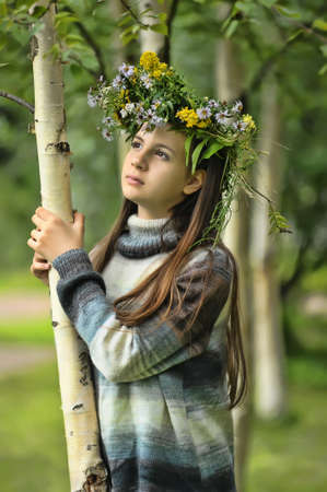 spring fashion: Teen girl with a wreath of flowers on her head Stock Photo