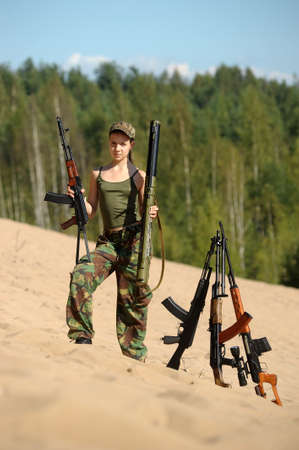 teen girl with a gun Stock Photo - 15371463