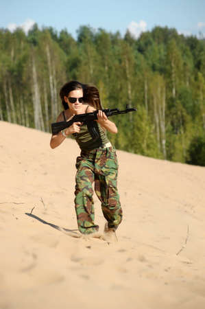 girl running with a gun Stock Photo - 15036241