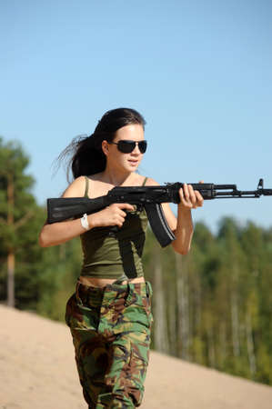 girl running with a gun Stock Photo - 15036041