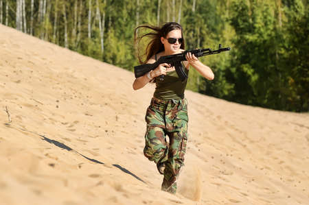 Beautiful woman soldier with a sniper rifle Stock Photo - 15036033