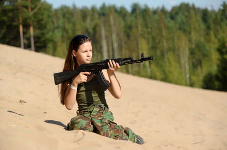 teen girl with a gun photo