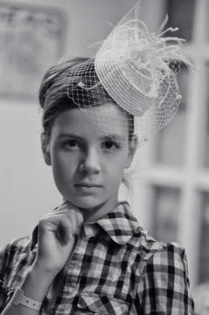 Face of young beautiful girl in a vintage hat  photo