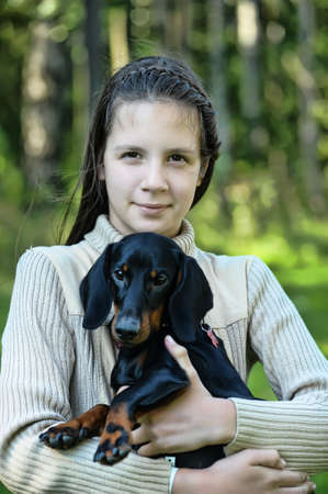 Dachshund and girl photo