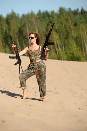 Armed beautiful young woman Stock Photo - 15232882