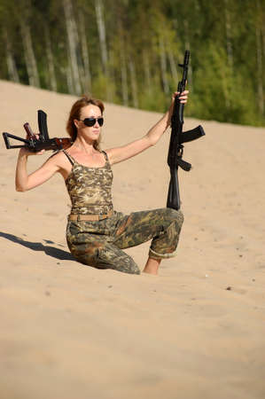 Armed beautiful young woman Stock Photo - 15232919