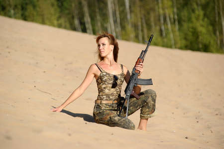Armed beautiful young woman  Stock Photo - 15232913