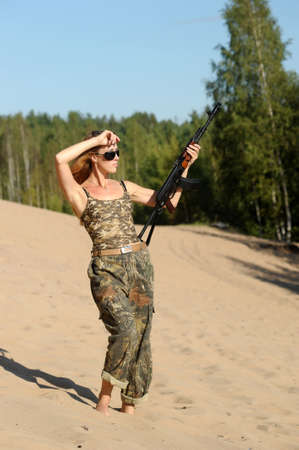 Armed beautiful young woman Stock Photo - 15232920