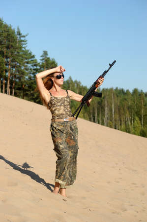 Armed beautiful young woman  photo