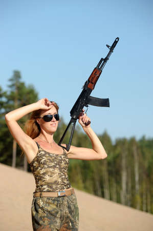 M16: Armed beautiful young woman