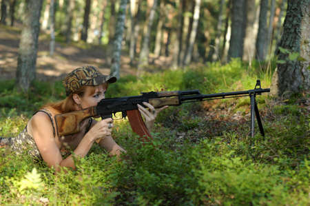 sniper training: Armed beautiful young woman