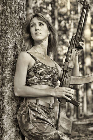 Armed beautiful young woman  Stock Photo - 15233210