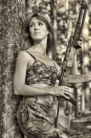 airsoft gun: Armed beautiful young woman