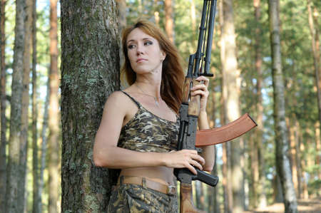 Armed beautiful young woman Stock Photo - 15232930