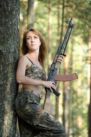 airgun: Armed beautiful young woman