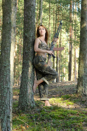 Armed beautiful young woman Stock Photo - 15232936