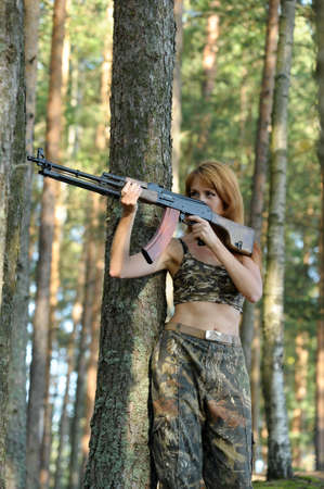 Armed beautiful young woman  Stock Photo - 15232932