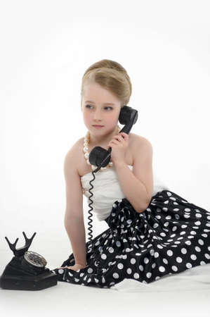 7 8 years: girl talking on retro phone