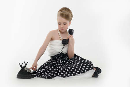 one parent: girl talking on retro phone