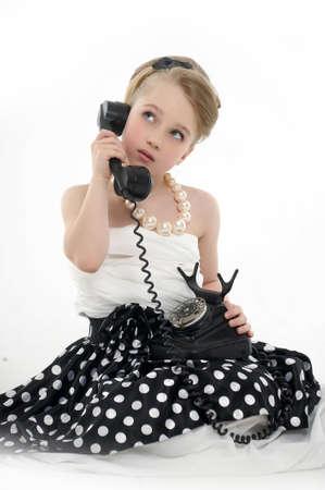 make a call: girl talking on retro phone