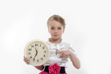 casual clothing 12 year old: he girl with the hair in the style of 40 s in the hands of his watch Stock Photo