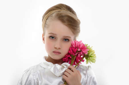 little girl with a retro hairstyle and flowers in their hands photo
