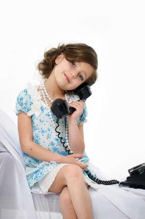 Little girl posing in her dress photo