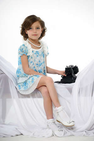 Little girl posing in her dress photo