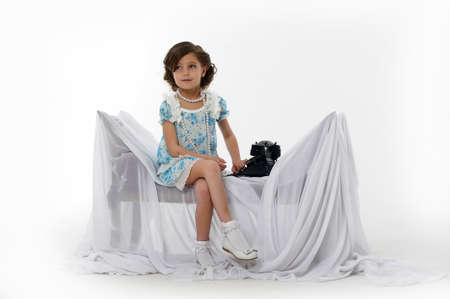 youngbaby: Little girl posing in her dress Stock Photo