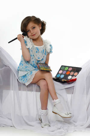 Little girl trying makeup isolated on white background Stock Photo - 16035397