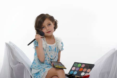 Little girl trying makeup isolated on white background Stock Photo - 16035365