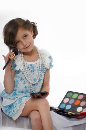 Little girl trying makeup isolated on white background Stock Photo - 16035396