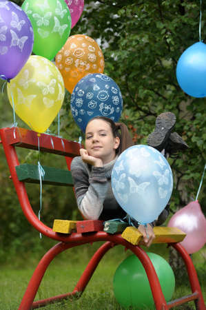 Cute girl among ballons  photo